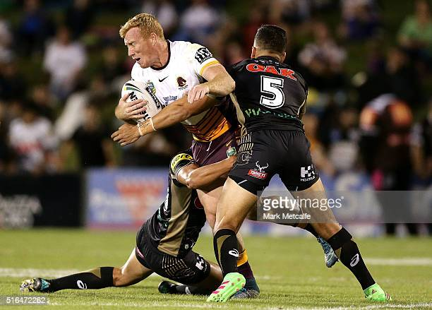 Jack Reed of the Broncos is tackled by Dallin WateneZelezniak of the Panthers during the round three NRL match between the Penrith Panthers and the...