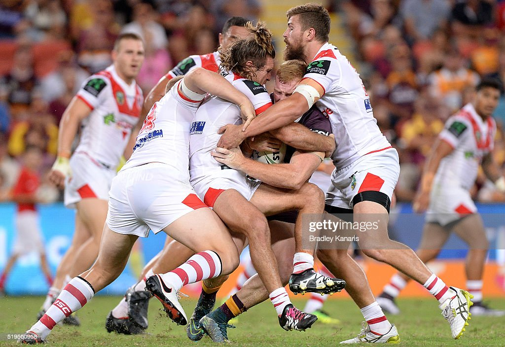 Jack Reed of the Broncos is wrapped up by the defence during the round six NRL match between the Brisbane Broncos and the St George Illawarra Dragons at Suncorp Stadium on April 7, 2016 in Brisbane, Australia.