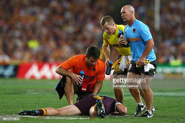 Jack Reed of the Broncos lays injured on the field during the 2015 NRL Grand Final match between the Brisbane Broncos and the North Queensland...