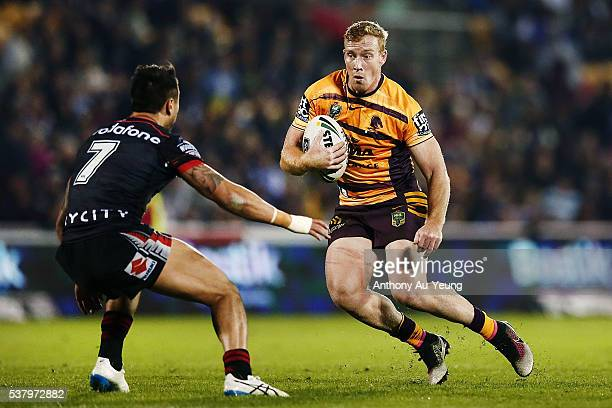Jack Reed of the Broncos makes a run at Shaun Johnson of the Warriors during the round 13 NRL match between the New Zealand Warriors and the Brisbane...