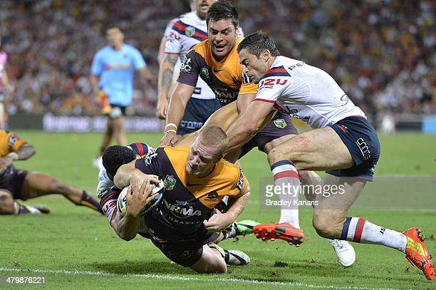 Jack Reed of the Broncos pushes his way through the defence to score a try during the round three NRL match between the Brisbane Broncos and the...