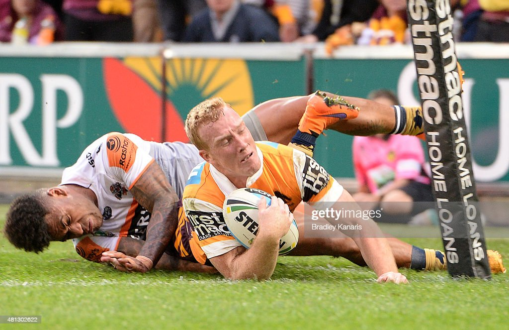 Jack Reed of the Broncos scores a try during the round 19 NRL match between the Brisbane Broncos and the Wests Tigers at Suncorp Stadium on July 19, 2015 in Brisbane, Australia.