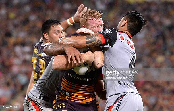 Jack Reed of the Broncos takes on the defence during the round two NRL match between the Brisbane Broncos and the New Zealand Warriors at Suncorp...