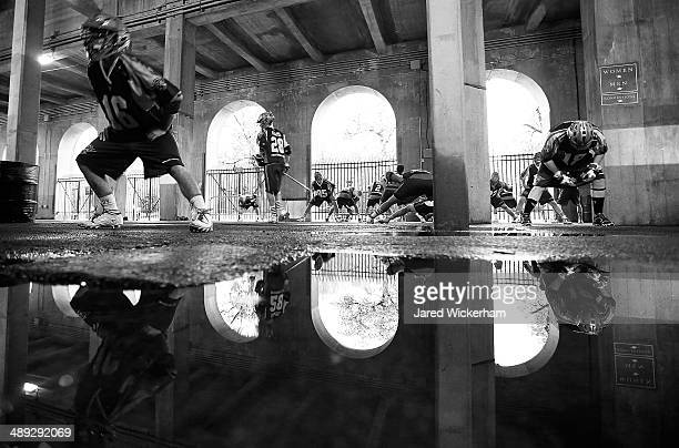 Jack Rice of the Boston Cannons and his teammates warm up underneath Harvard Stadium following the first half against the Denver Outlaws on May 10...