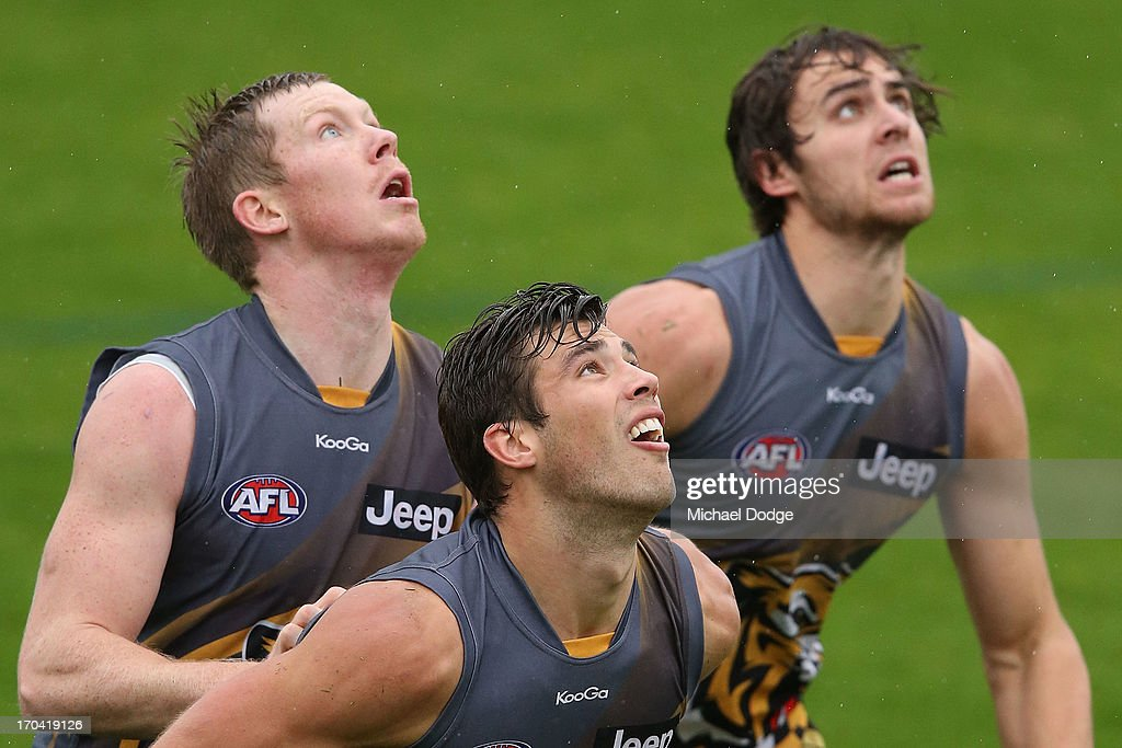 Jack Riewoldt (L) Alex Rance (C) and Ben Griffiths contest for the ball during a Richmond Tigers AFL training session at ME Bank Centre on June 13, 2013 in Melbourne, Australia.