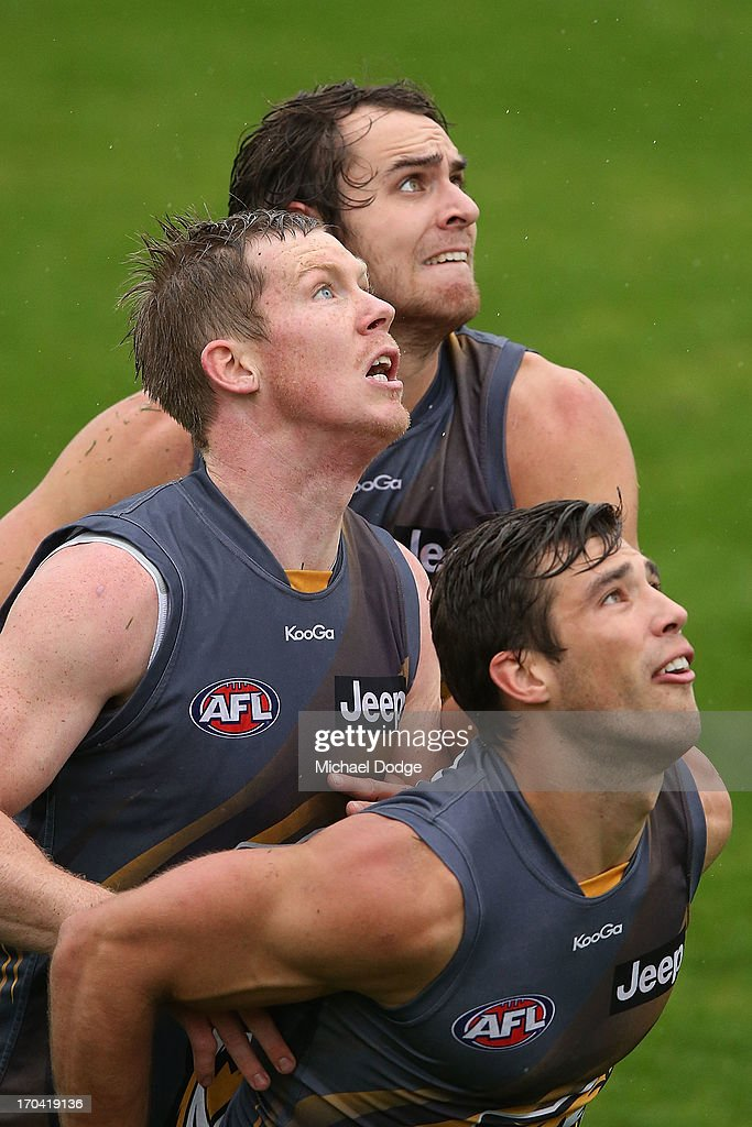 Jack Riewoldt (L) Alex Rance (R) and Ben Griffiths contest for the ball during a Richmond Tigers AFL training session at ME Bank Centre on June 13, 2013 in Melbourne, Australia.