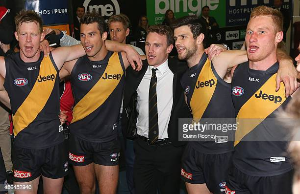 Jack Riewoldt Alex Rance Nathan Foley Trent Cotchin and Nick Vlastuin of the Tigers sing the song in the rooms after winning the round 23 AFL match...