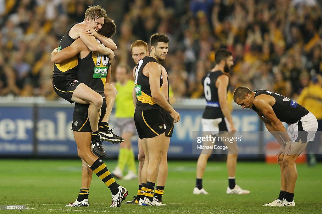 Jack Riewoldt (L) and Shaun Hampson of the Tigers celebrate their win on the final siren as Ed Curnow (R) of the blues reacts during the round two AFL match between the Richmond Tigers and the Carlton Blues at Melbourne Cricket Ground on March 27, 2014 in Melbourne, Australia.
