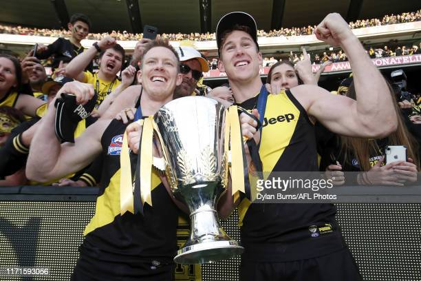 Jack Riewoldt and Tom Lynch of the Tigers celebrate with the premiership cup after the 2019 Toyota AFL Grand Final match between the Richmond Tigers...