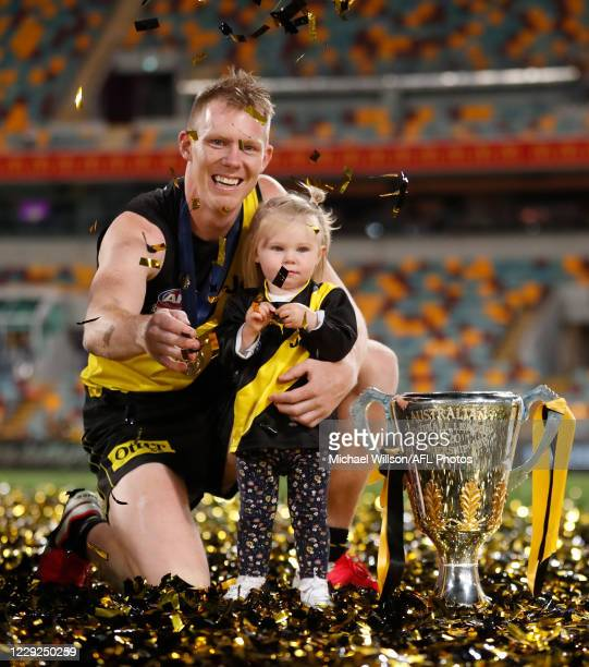 Jack Riewoldt of the Tigers and daughter Poppy celebrate during the 2020 Toyota AFL Grand Final match between the Richmond Tigers and the Geelong...