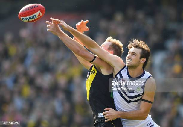 Jack Riewoldt of the Tigers and Joel Hamling of the Dockers compete for a mark during the round eight AFL match between the Richmond Tigers and the...