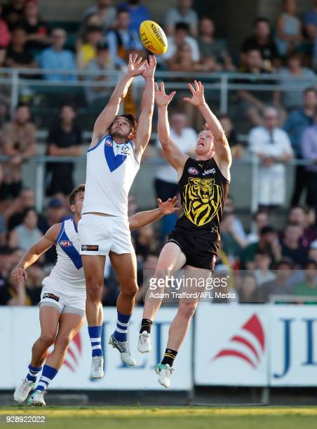 Jack Riewoldt of the Tigers and Robbie Tarrant of the Kangaroos compete for the ball during the AFL 2018 JLT Community Series match between the...