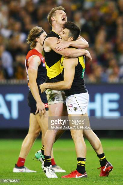 Jack Riewoldt of the Tigers and Trent Cotchin of the Tigers celebrate a goal during the 2018 AFL round five match between the Melbourne Demons and...