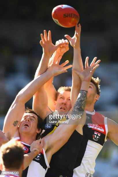 Jack Riewoldt of the Tigers attempts to mark over the top of Jake Carlisle of the Saints during the round 10 AFL match between the Richmond Tigers...
