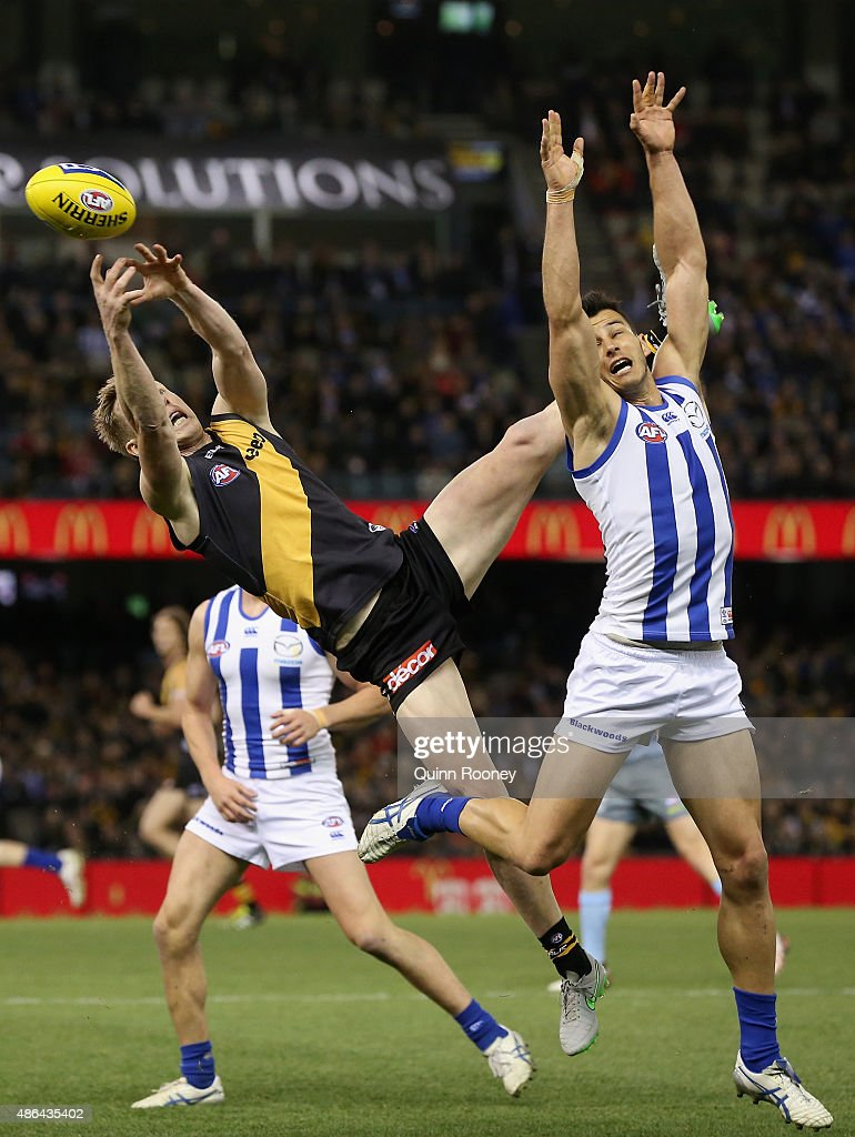 Jack Riewoldt of the Tigers attempts to mark over the top of Robbie Tarrant of the Kangaroos during the round 23 AFL match between the Richmond Tigers and the North Melbourne Kangaroos at Etihad Stadium on September 4, 2015 in Melbourne, Australia.