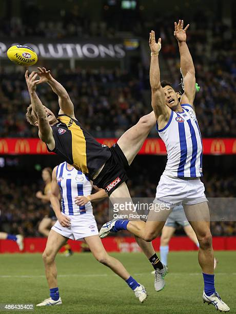 Jack Riewoldt of the Tigers attempts to mark over the top of Robbie Tarrant of the Kangaroos during the round 23 AFL match between the Richmond...