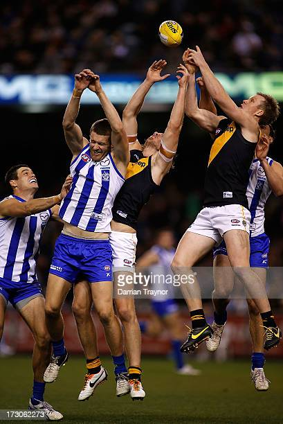 Jack Riewoldt of the Tigers attempts to mark the ball during the round 15 AFL match between the North Melbourne Kangaroos and the Richmond Tigers at...