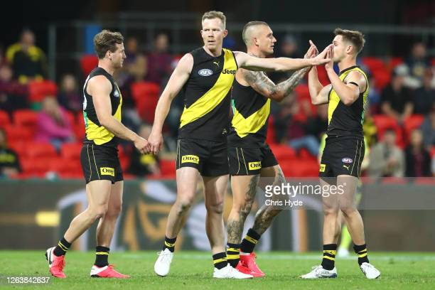 Jack Riewoldt of the Tigers celebrates a goal during the round 10 AFL match between the Richmond Tigers and the Brisbane Lions at Metricon Stadium on...