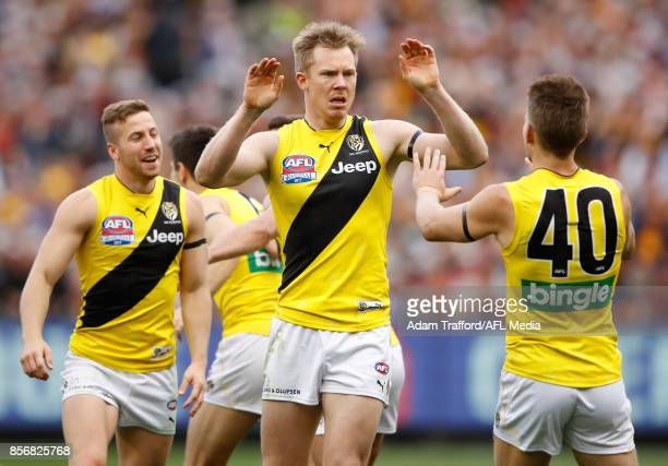 Jack Riewoldt of the Tigers celebrates a goal with Dan Butler of the Tigers during the 2017 Toyota AFL Grand Final match between the Adelaide Crows...
