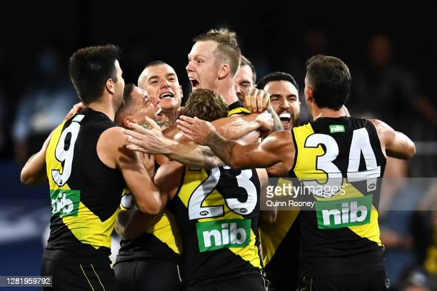 Jack Riewoldt of the Tigers celebrates kicking a goal with team mates during the 2020 AFL Grand Final match between the Richmond Tigers and the...