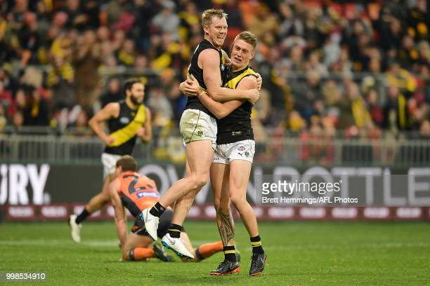 Jack Riewoldt of the Tigers celebrates kicking a goal with team mates during the round 17 AFL match between the Greater Western Sydney Giants and the...