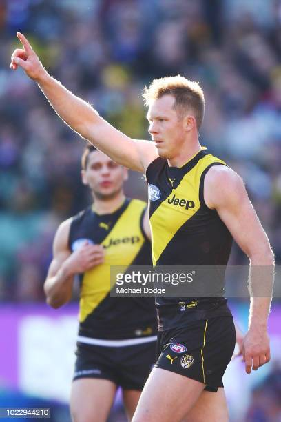Jack Riewoldt of the Tigers celebrates kicking his 600th goal during the round 23 AFL match between the Richmond Tigers and the Western Bulldogs at...