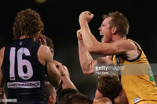 Jack Riewoldt of the Tigers celebrates winning as the final siren sounds during the round 10 AFL match between the Fremantle Dockers and the Richmond...