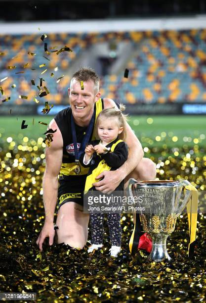 Jack Riewoldt of the Tigers celebrates winning with his daughter Poppy, after the 2020 AFL Grand Final match between the Richmond Tigers and the...