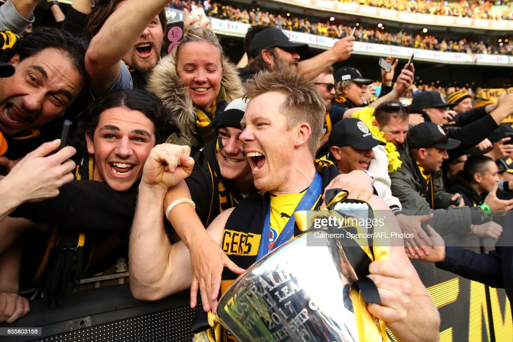 Jack Riewoldt of the Tigers celebrates with fans after winning the 2017 AFL Grand Final match between the Adelaide Crows and the Richmond Tigers at Melbourne Cricket Ground on September 30, 2017 in Melbourne, Australia.