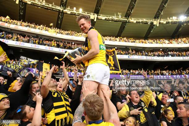 Jack Riewoldt of the Tigers celebrates with fans after winning the 2017 AFL Grand Final match between the Adelaide Crows and the Richmond Tigers at...