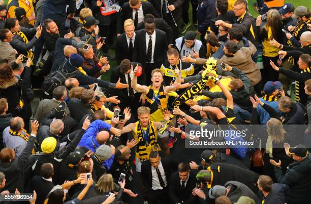 Jack Riewoldt of the Tigers celebrates with supporters in the crowd as the Tigers make their way to the changing rooms after winning the 2017 AFL...
