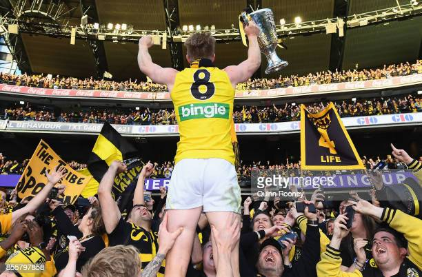 Jack Riewoldt of the Tigers celebrates with the Premiership Trophy after winning the 2017 AFL Grand Final match between the Adelaide Crows and the...
