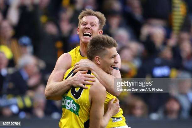 Jack Riewoldt of the Tigers congratulates team mate Dan Butler of the Tigers after kicking a goal during the 2017 AFL Grand Final match between the...