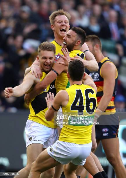 Jack Riewoldt of the Tigers congratulates team mate Dan Butler of the Tigers with team mates after kicking a goal during the 2017 AFL Grand Final...