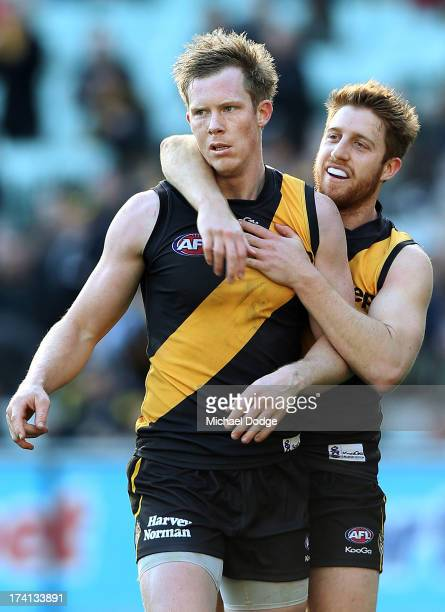 Jack Riewoldt of the Tigers is hugged by teamate Reece Conca after kicking a goal during the round 17 AFL match between the Richmond Tigers and the...