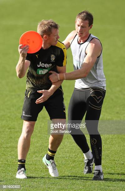 Jack Riewoldt of the Tigers is tackled by Dylan Grimes of the Tigers as they play a game with a frisbee during the Richmond Tigers AFL training...