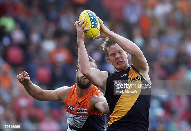 Jack Riewoldt of the Tigers marks in front of Tim Mohr of the Giants during the round 22 AFL match between the Greater Western Sydney Giants and the...
