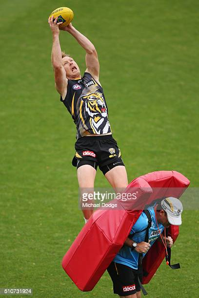 Jack Riewoldt of the Tigers marks the ball during a Richmond Tigers AFL media session at Punt Road Oval on February 17 2016 in Melbourne Australia
