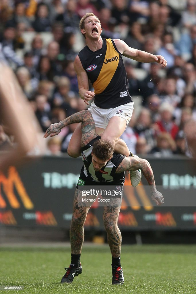 Jack Riewoldt of the Tigers marks the ball over Dane Swan of the Magpies during the round 21 AFL match between the Collingwood Magpies and the Richmond Tigers at Melbourne Cricket Ground on August 22, 2015 in Melbourne, Australia.