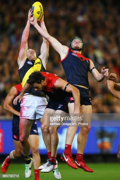 Jack Riewoldt of the Tigers marks the ball over Michael Hibberd and Angus Brayshaw of the Demons during the 2018 AFL round five match between the...