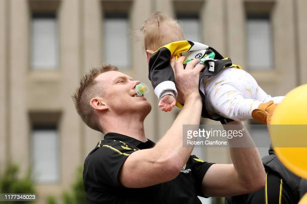 Jack Riewoldt of the Tigers plays with his son during the 2019 AFL Grand Final Parade on September 27, 2019 in Melbourne, Australia.