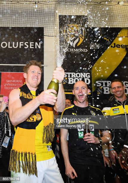 Jack Riewoldt of the Tigers pops some champagne in the rooms after winning the 2017 AFL Grand Final match between the Adelaide Crows and the Richmond...