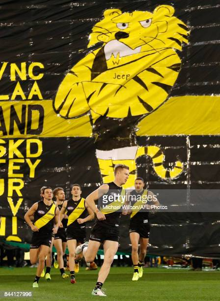 Jack Riewoldt of the Tigers runs through the banner during the AFL Second Qualifying Final Match between the Geelong Cats and the Richmond Tigers at...