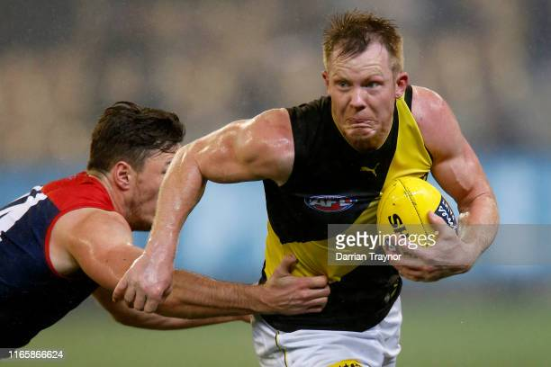 Jack Riewoldt of the Tigers shrugs a tackle during the round 20 AFL match between the Melbourne Demons and the Richmond Tigers at Melbourne Cricket...