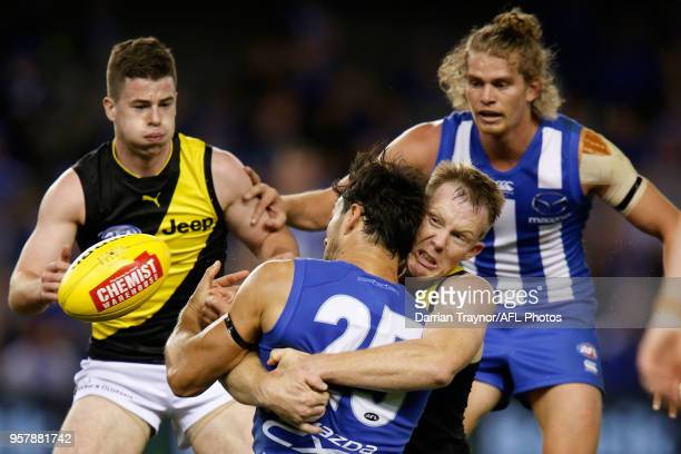 Jack Riewoldt of the Tigers tackles Robbie Tarrant of the Kangaroos during the round eight AFL match between the North Melbourne Kangaroos and the...