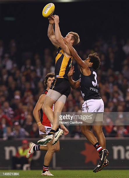 Jack Riewoldt of the Tigers takes a mark during the round 10 AFL match between the St Kilda Saints and the Richmond Tigers at Etihad Stadium on June...