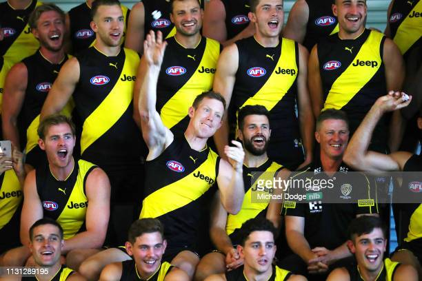 Jack Riewoldt of the Tigers throws paper balls at media as Trent Cotchin reacts during the AFL Richmond Tigers team photo session at Punt Road Oval...
