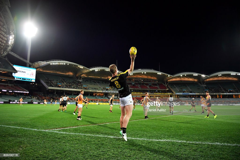 Jack Riewoldt of the Tigers throws the ball in during a match prior to the the round 15 AFL match between the Port Adelaide Power and the Richmond Tigers at Adelaide Oval on July 1, 2017 in Adelaide, Australia.