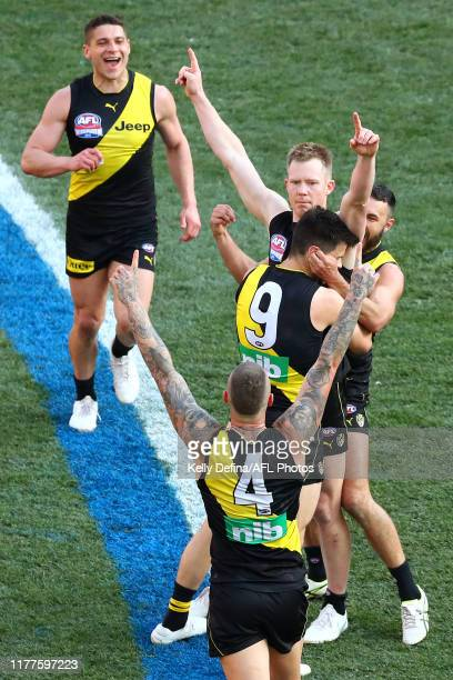 Jack Riewoldt of the Tigers , Trent Cotchin of the Tigers, Dustin Martin of the Tigers and team mates celebrate during the 2019 AFL Grand Final match...