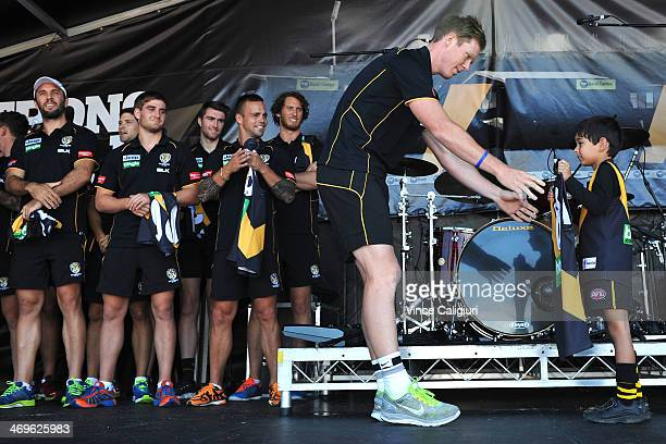 Jack Riewoldt receives his 2014 jumper during the Richmond Tigers AFL Family Day on February 16 2014 in Melbourne Australia